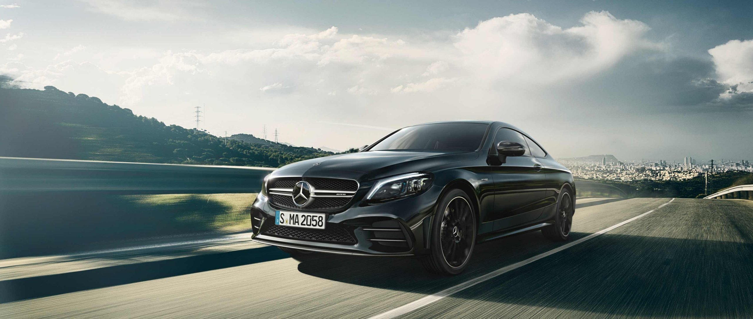 2018er Mercedes-AMG C 43 4MATIC Coupé (C 205) MoPf mit AMG Carbon-Paket II in Obsidianschwarz metallic.