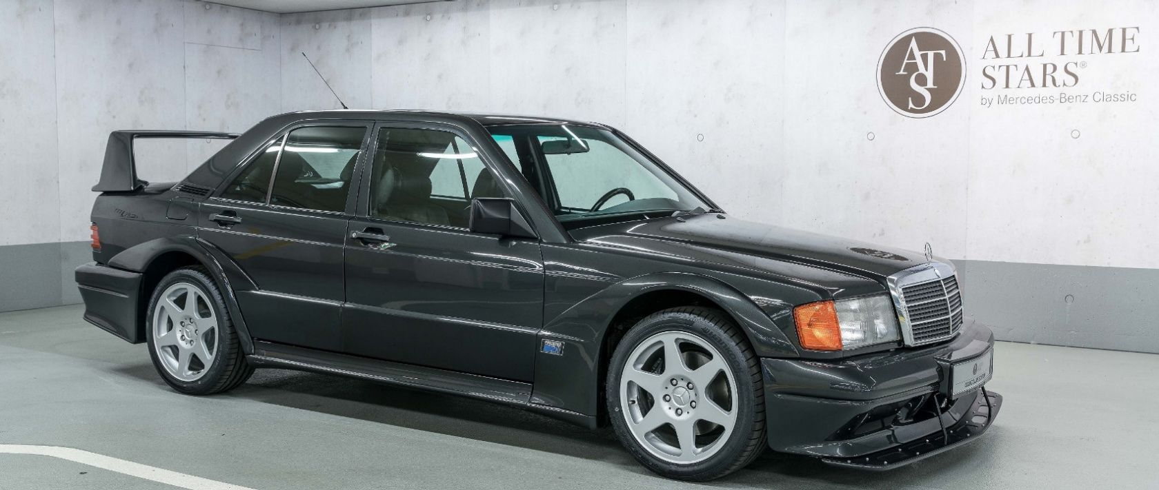 Release the beast: The Mercedes-Benz 190 E 2.5-16 EVO 2 is ready for roaring in the shady darkness of the parking lot.
