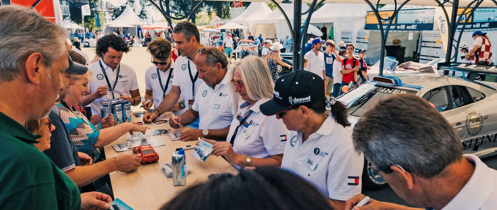 Very close to the fans: Mercedes-Benz Brand Ambassadors Luca Ludwig, Sebastian Asch, Karl Wendlinger, Klaus Ludwig, Jutta Benz, Ellen Lohr and Roland Asch (from left) at the Mercedes-Benz Classic booth during the 2019 Classic Days Schloss Dyck.