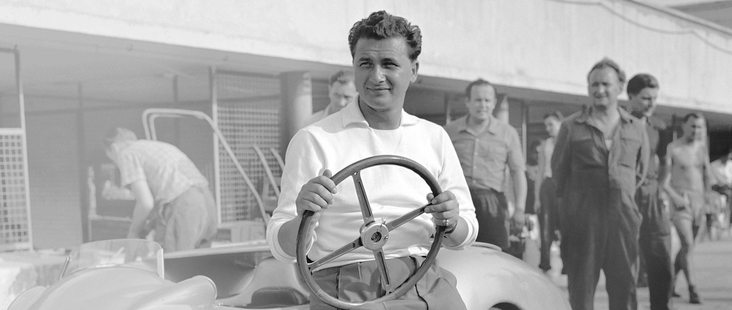 Mercedes-Benz works driver Hans Herrmann in August 1955, during test drives on the Autodrome in Monza.