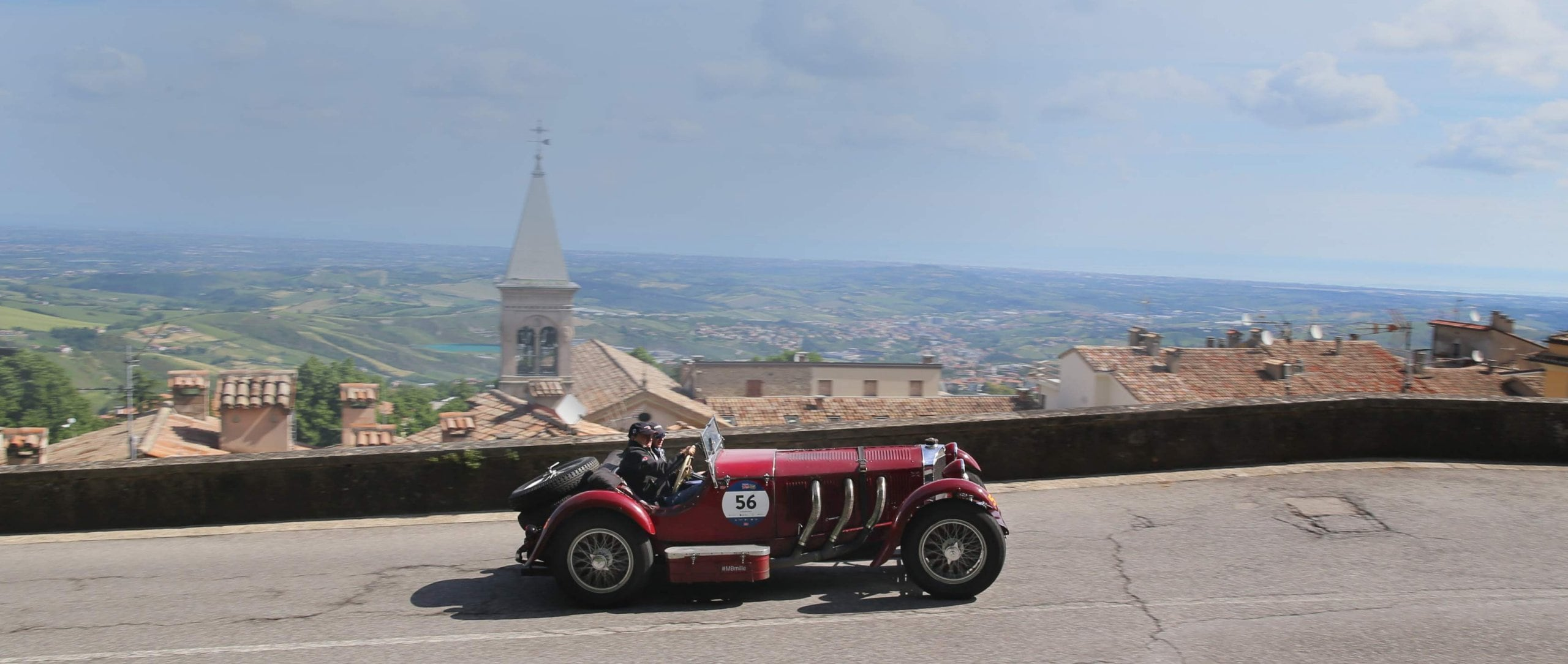 The classic vehicles, like this Mercedes-Benz SSK, are not the only spectacular sights worth seeing in the Mille Miglia.