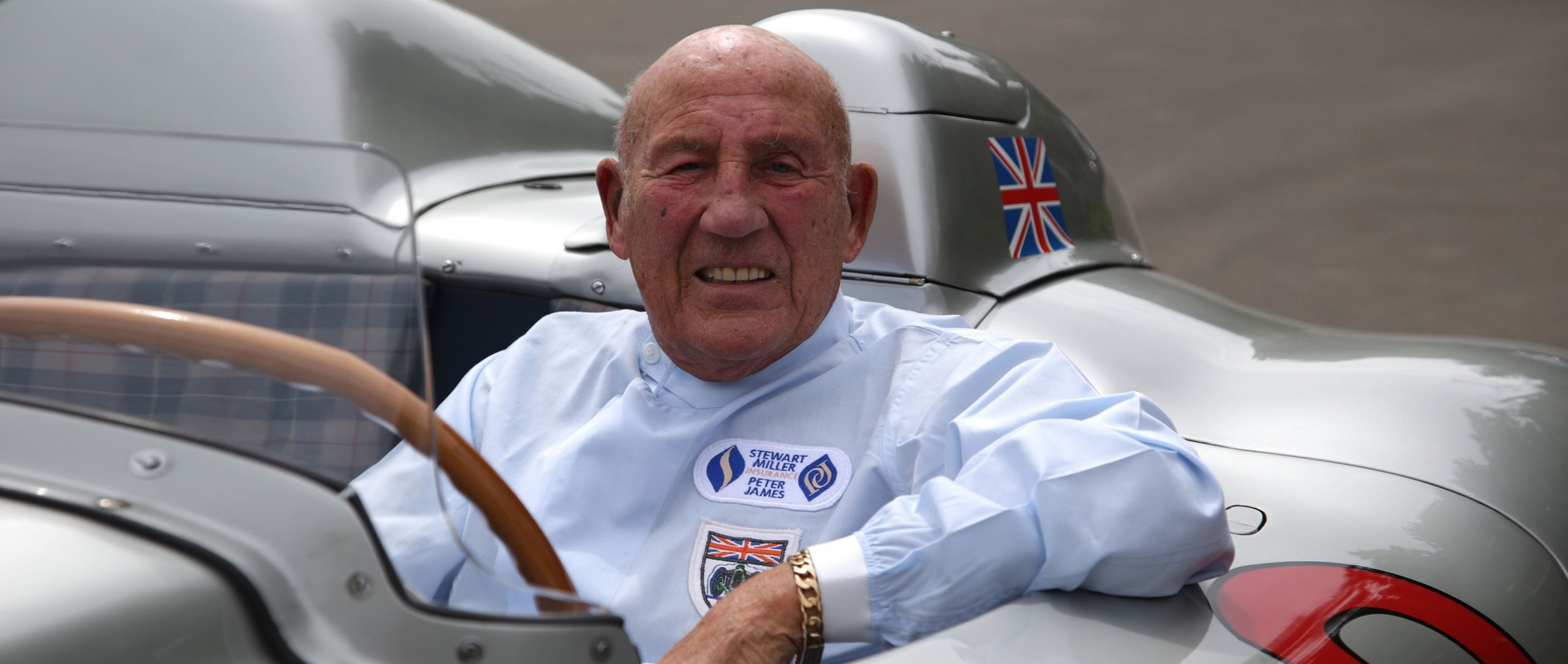 Sir Stirling Moss at the wheel of the Mercedes-Benz 300 SLR racing car (W 196 S) with start number 722. Photo from 2015.