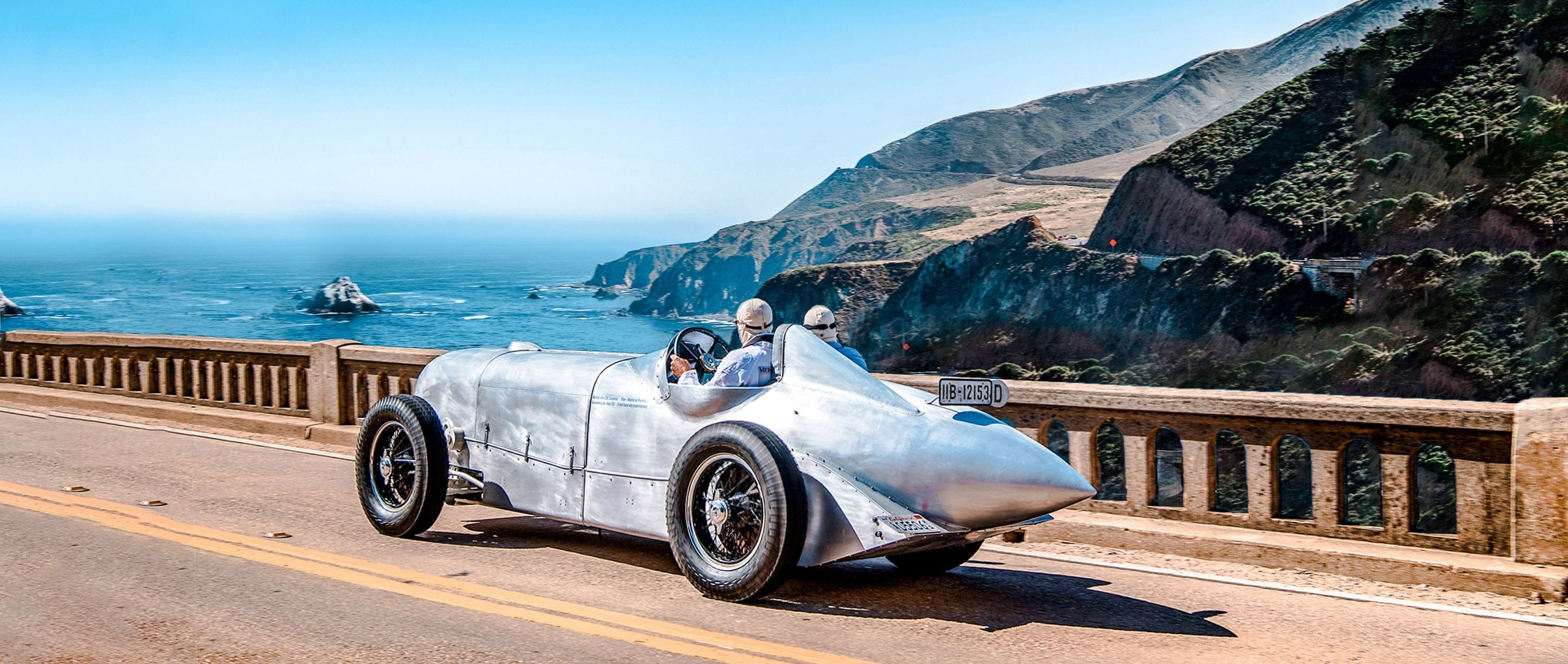 In the spectacular Mercedes-Benz SSKL streamlined racing car on the Pacific Coast Highway heading south, always looking to the roaring Pacific Ocean at the right.