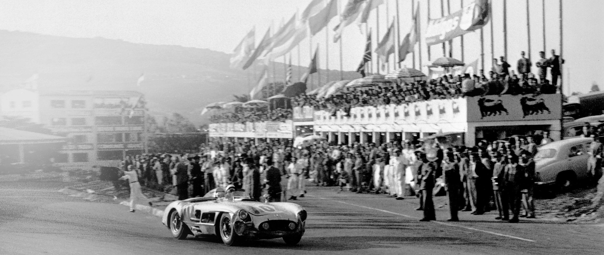 Stirling Moss in the Mercedes-Benz 300 SLR racing sports car with start number 104 winning the 1955 Targa Florio.