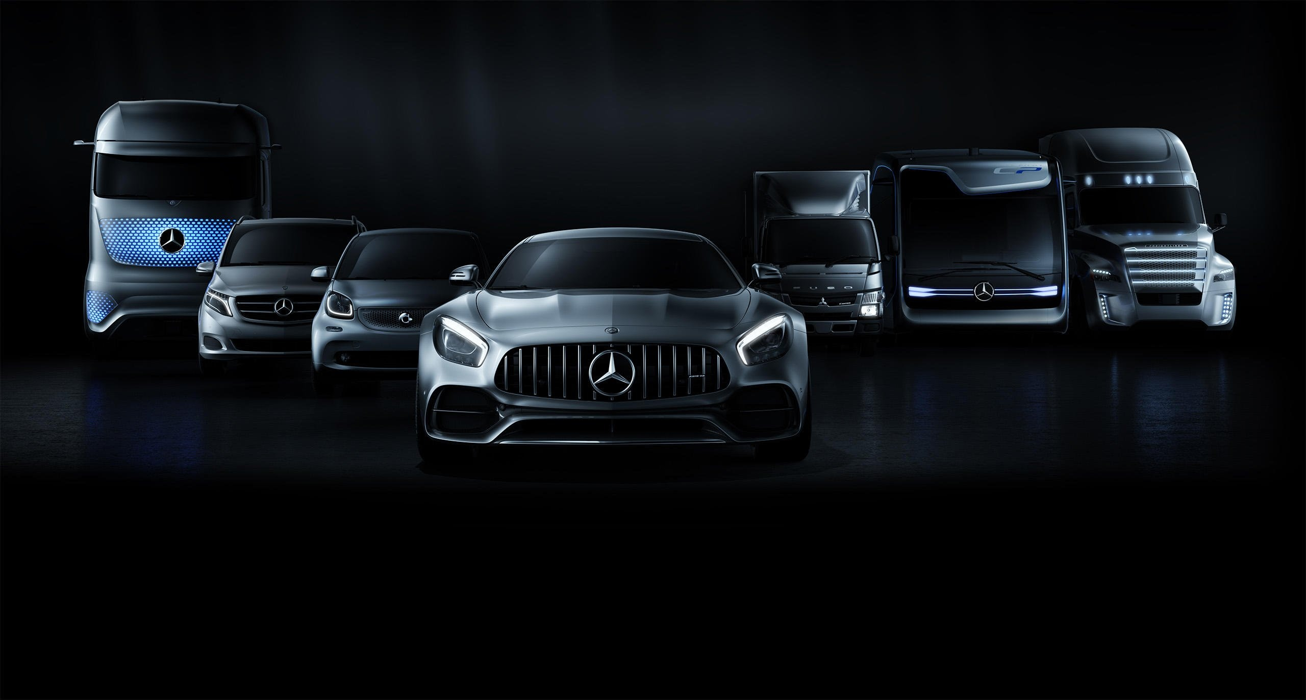 Frontal view of different Mercedes-Benz cars and commercial vehicles.