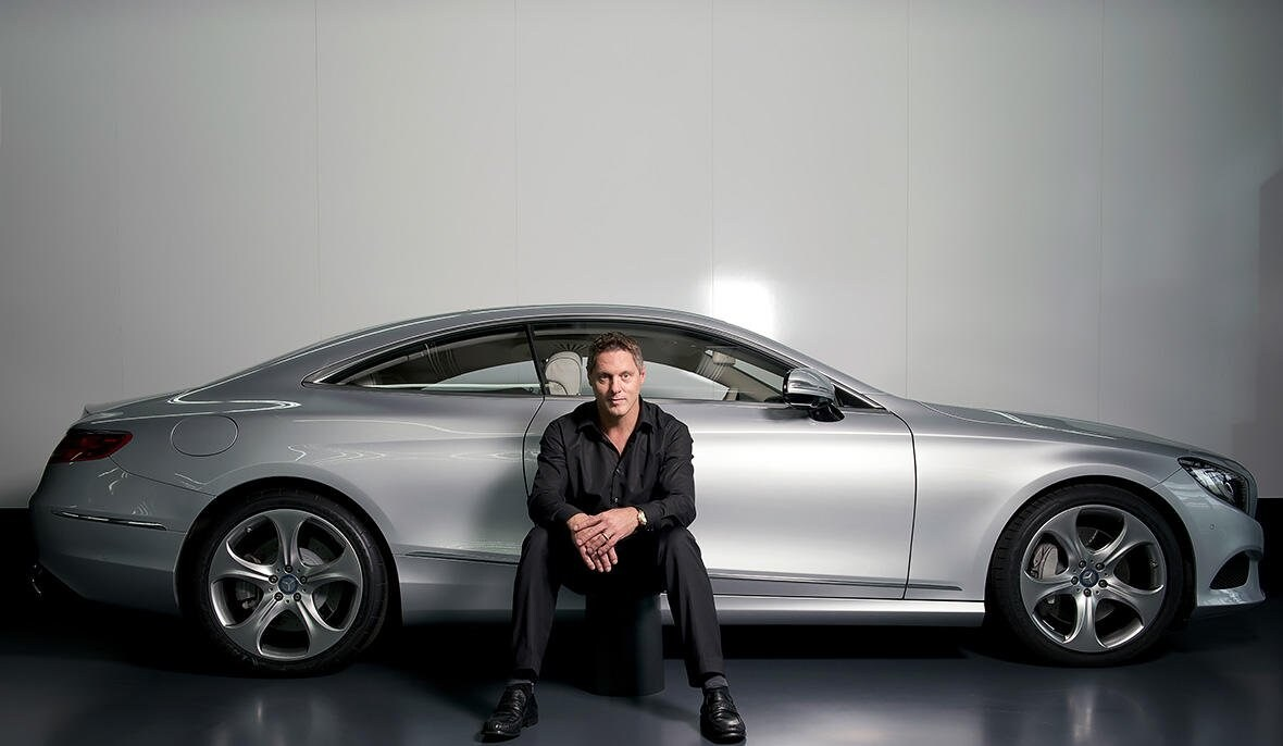 Gorden Wagener, Head of Design Daimler AG, in front of a Mercedes-Benz vehicle.