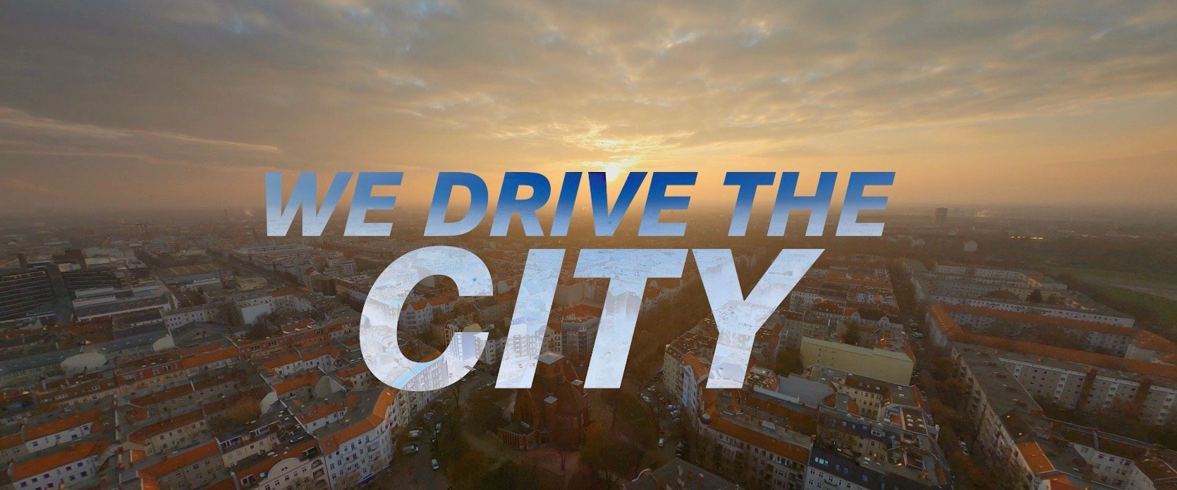 we drive the city lettering
