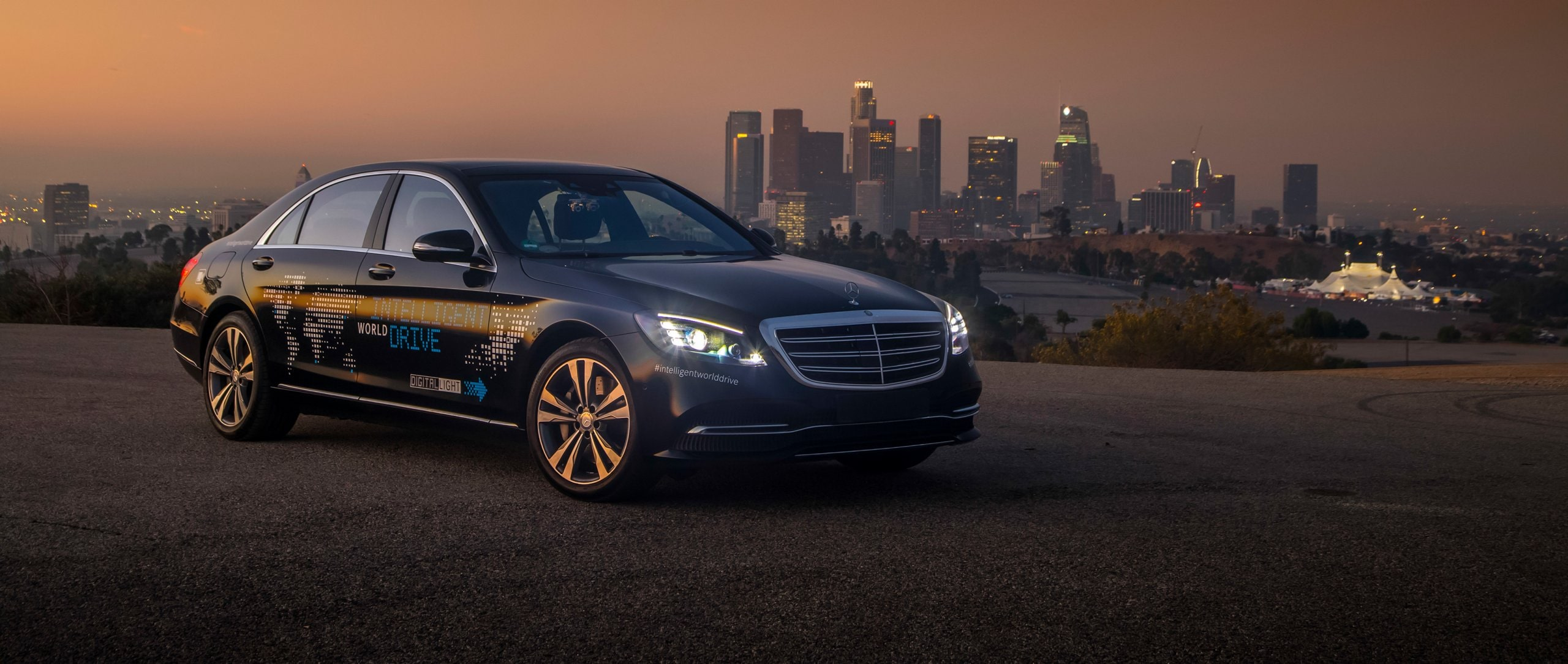 The Mercedes-Benz S-Class in black in front of a skyline.