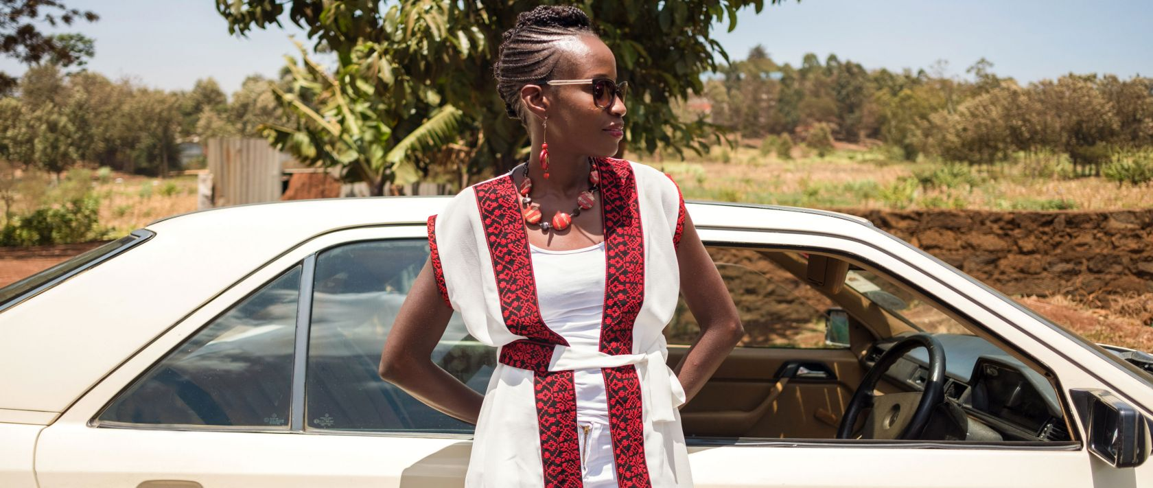 Daisy Namayi stands in front of her beloved ivory Mercedes-Benz W 124 Saloon.