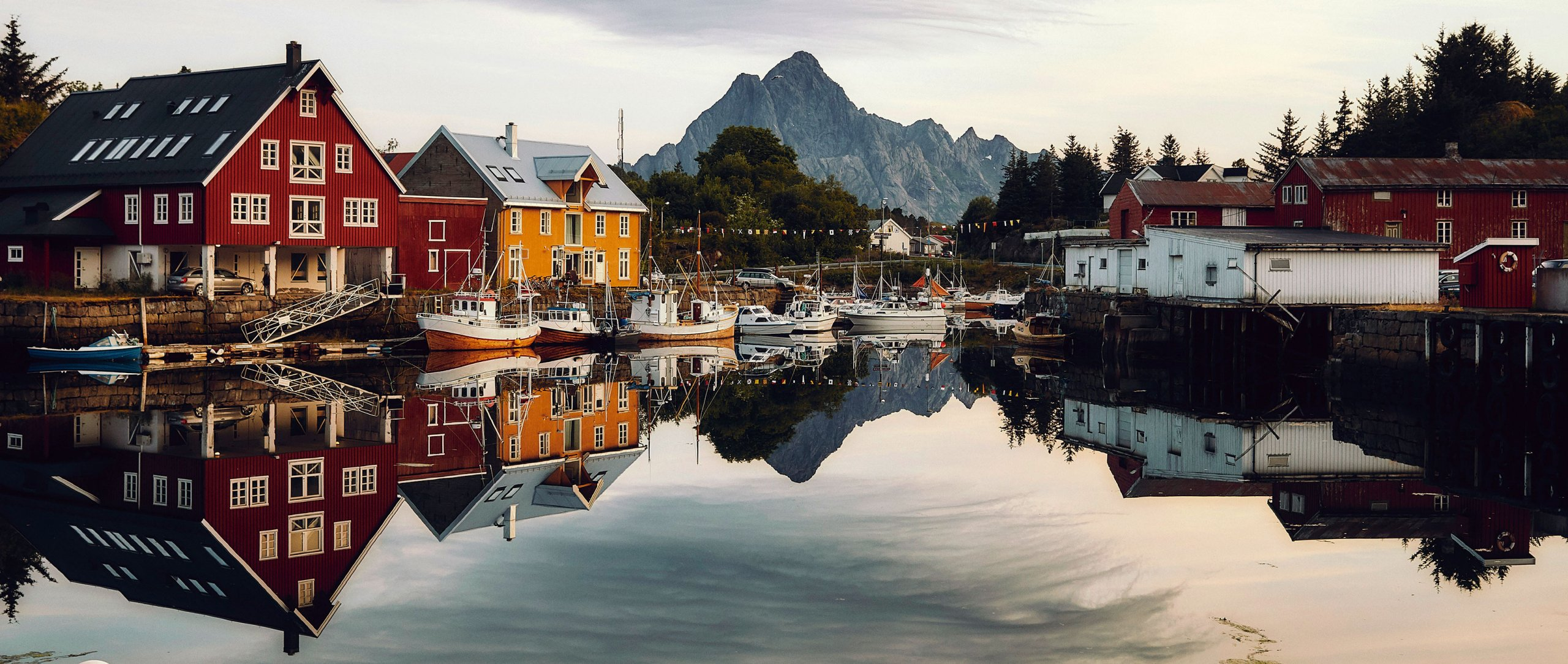 Dream destination: Colourful houses and fishing boats frame the hills and are reflected in the water. The light in the Lofoten islands is at times surreally magical.