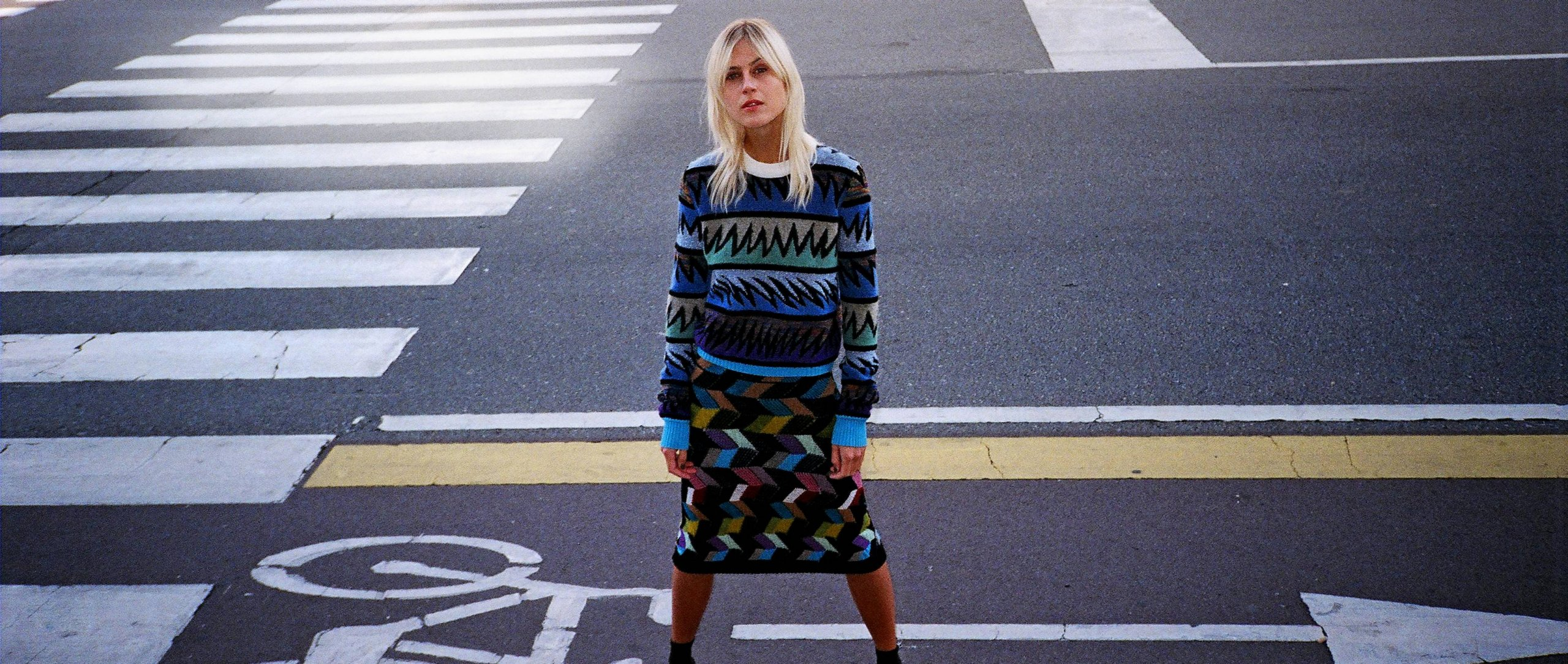 Mercedes-Benz Fashion 2017 Round-Up: Woman standing on street.