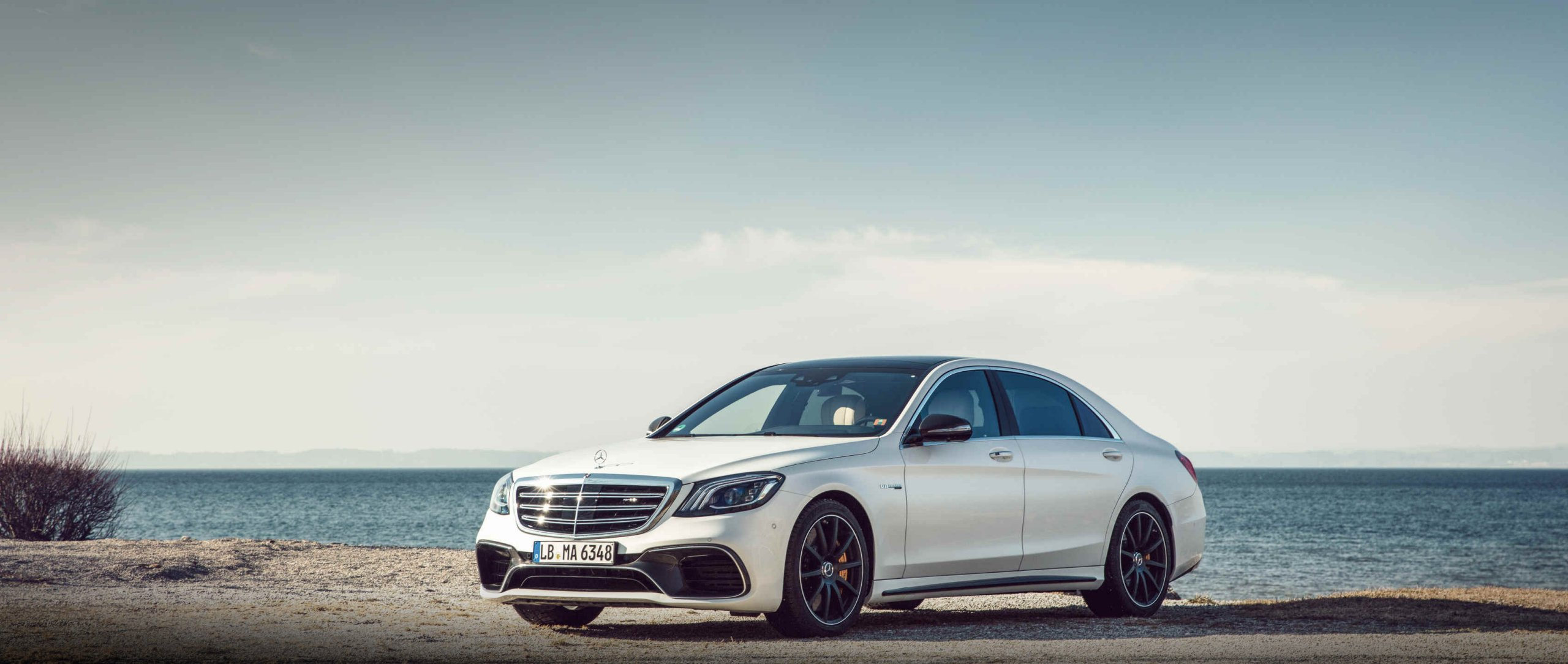 Mercedes-AMG S 63 4MATIC+ (V222) in designo diamond white bright with 4.0-litre V8 biturbo engine.