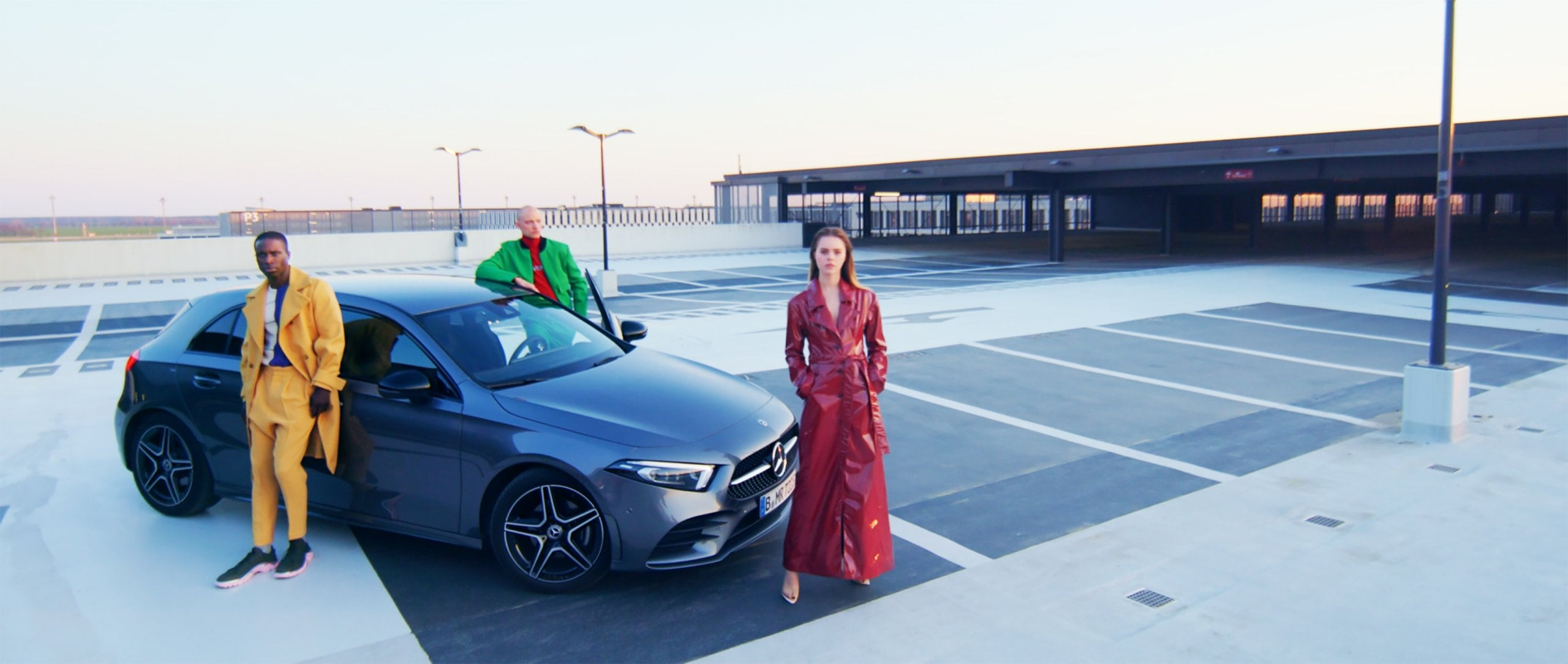 Three models standing in front of the Mercedes-Benz A-Class