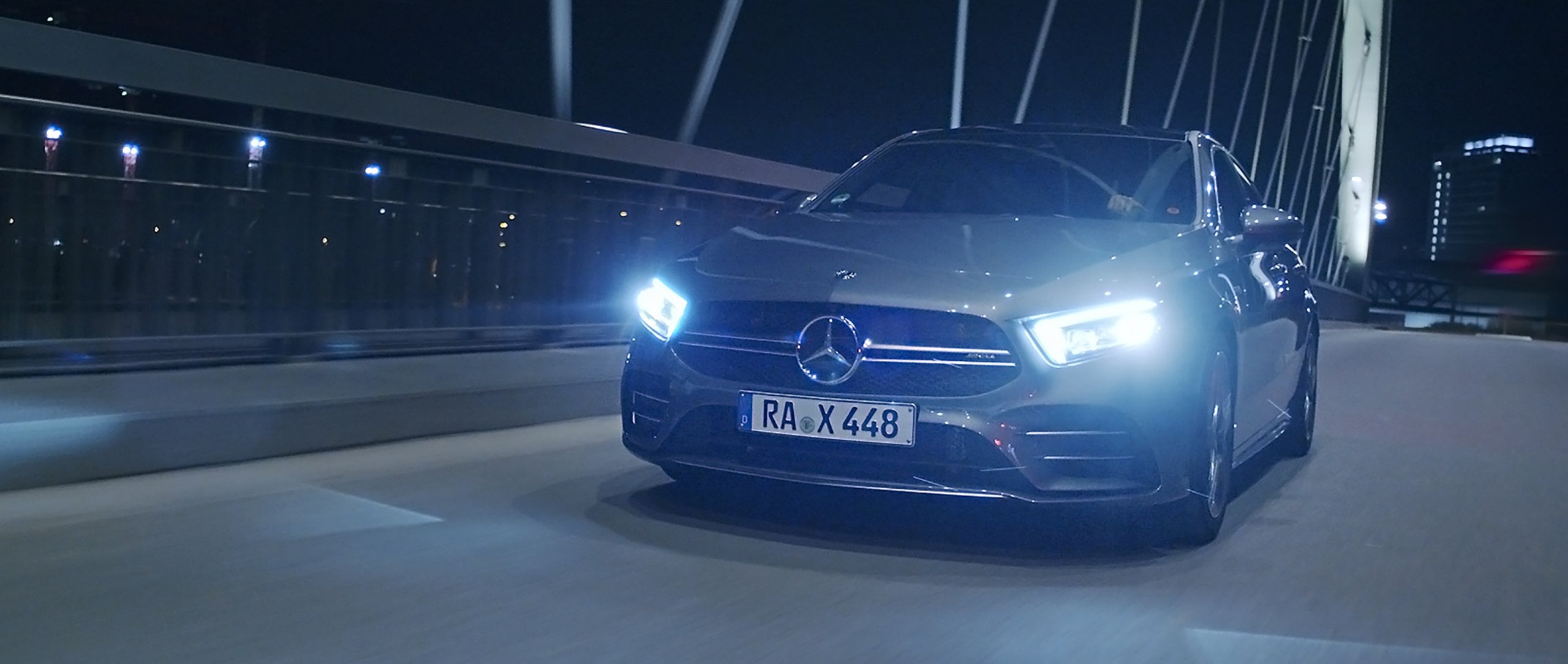 The Mercedes-AMG A 35 4MATIC Saloon on a road at night.