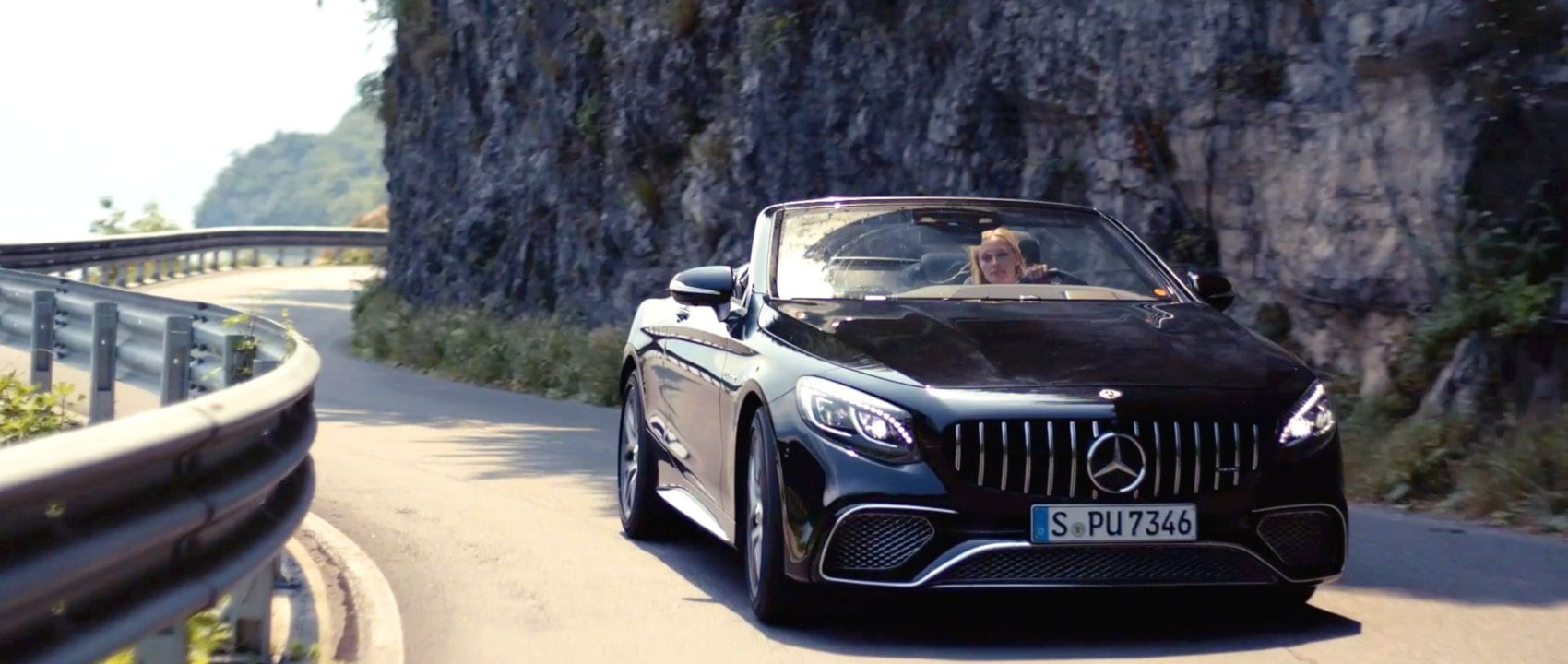 The Mercedes-AMG S 65 Cabriolet (A 217) in black on a country road at Lake Como in Italy.