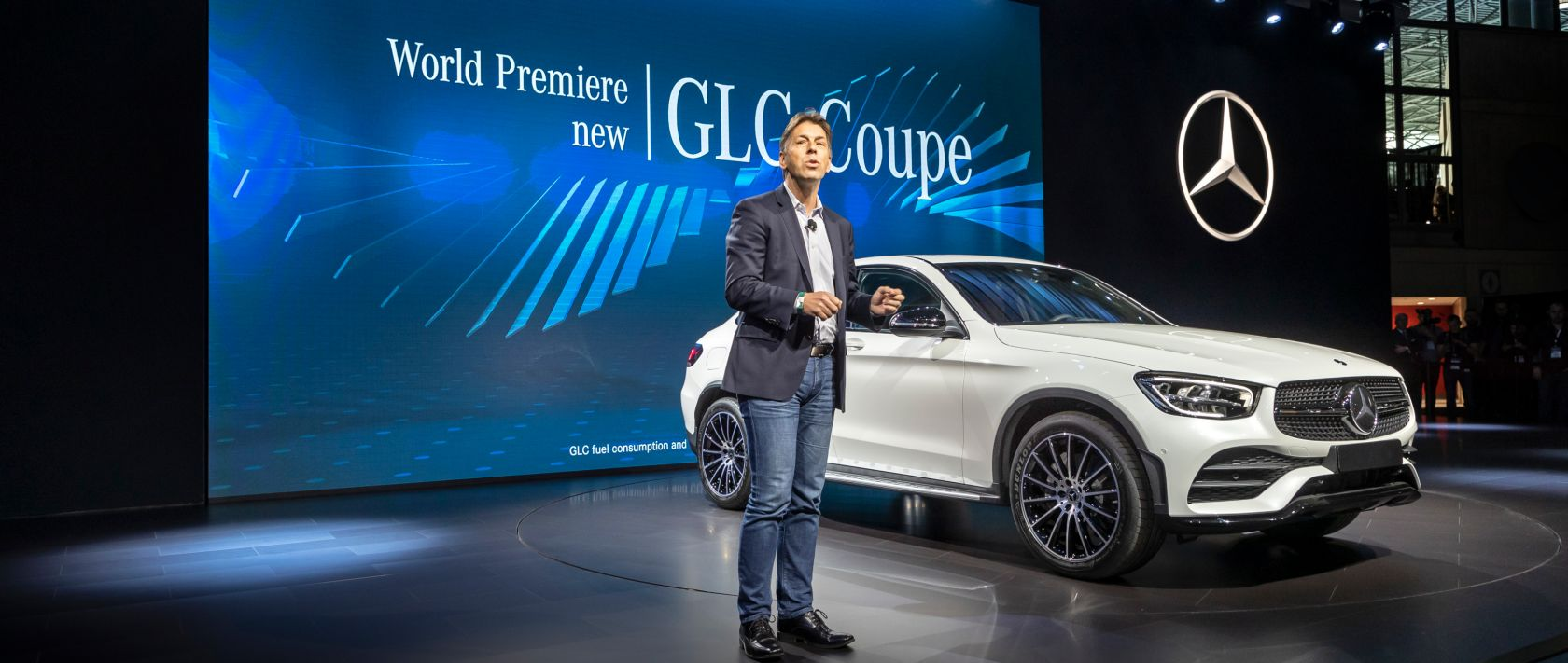 Dietmar Exler, President & CEO of Mercedes-Benz USA, presenting the new Mercedes-Benz GLC Coupé (C 253) in designo diamond white bright at the 2019 New York International Auto Show.