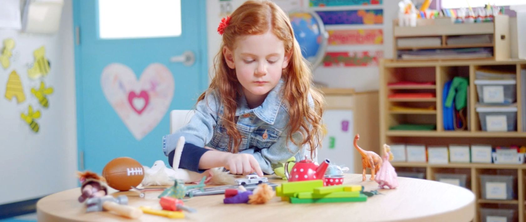 A young girl is playing with toys.