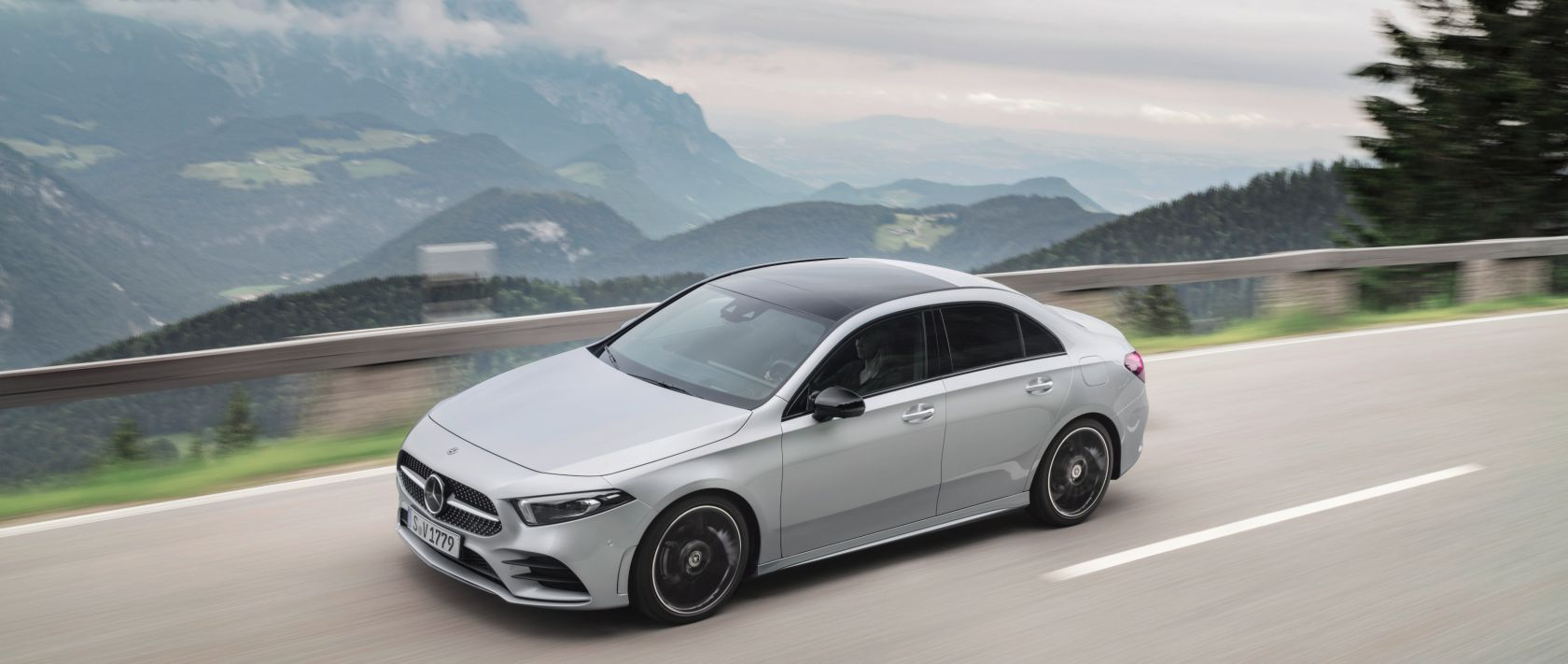 The new 2019 Mercedes-Benz A-Class Saloon (V 177) AMG Line black in iridium silver on a country road.