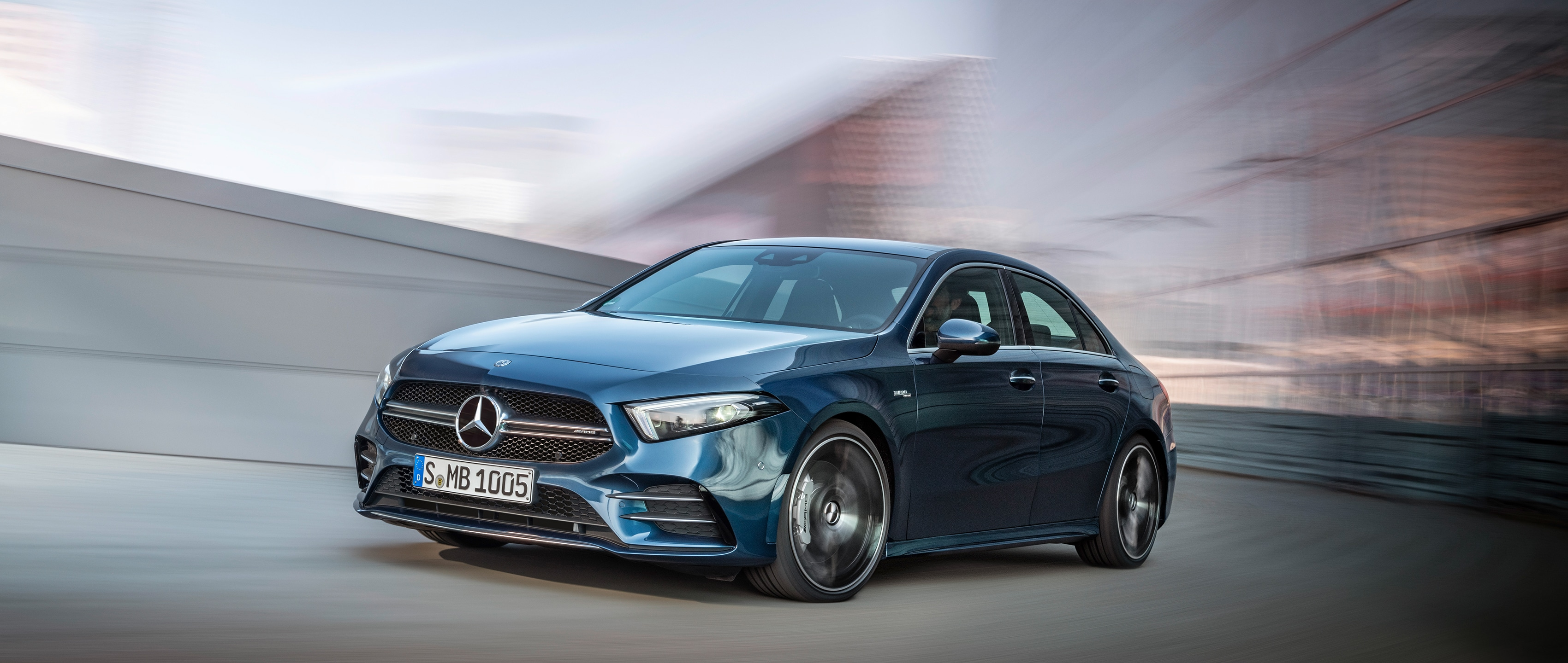 The new 2019 Mercedes-AMG A 35 4MATIC Saloon (V 177) in denim blue metallic in dynamic cornering.