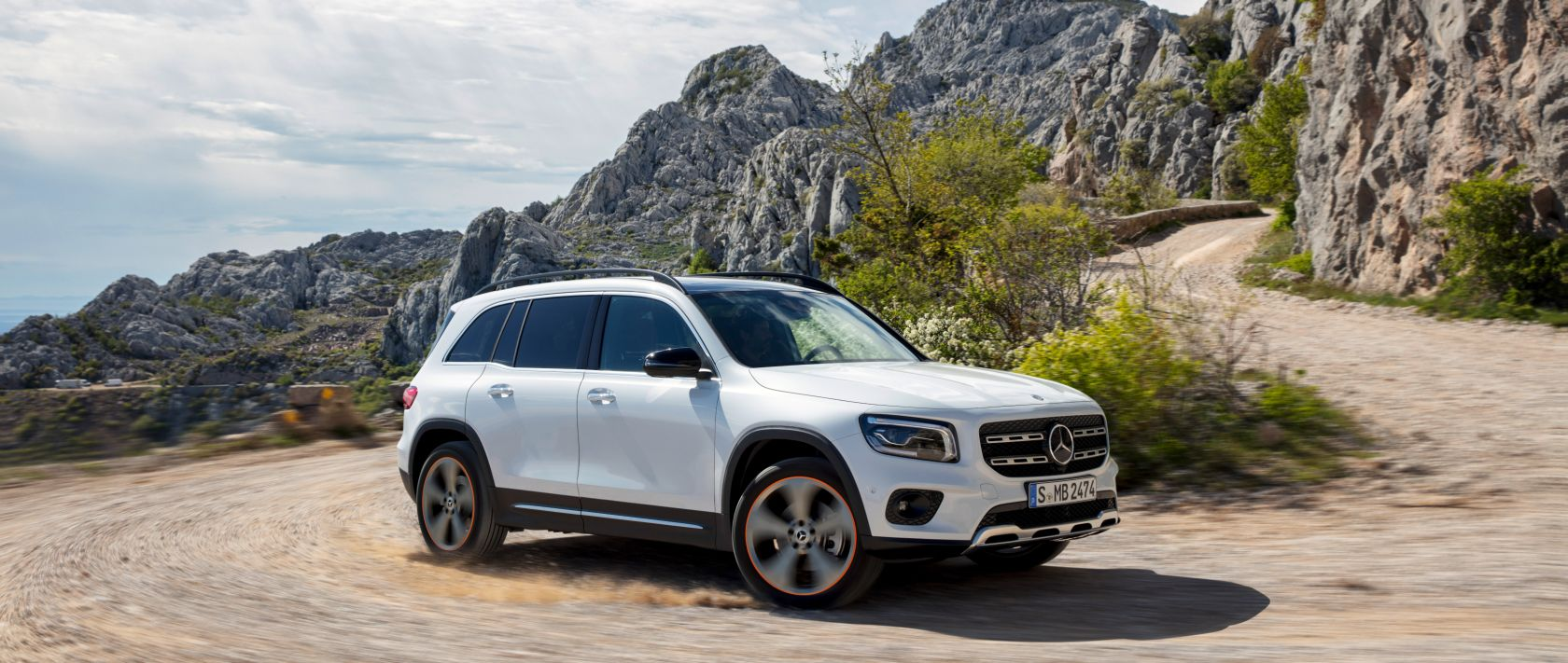 The new 2020 Mercedes-Benz GLB (X 247) in polar white on a rough road.