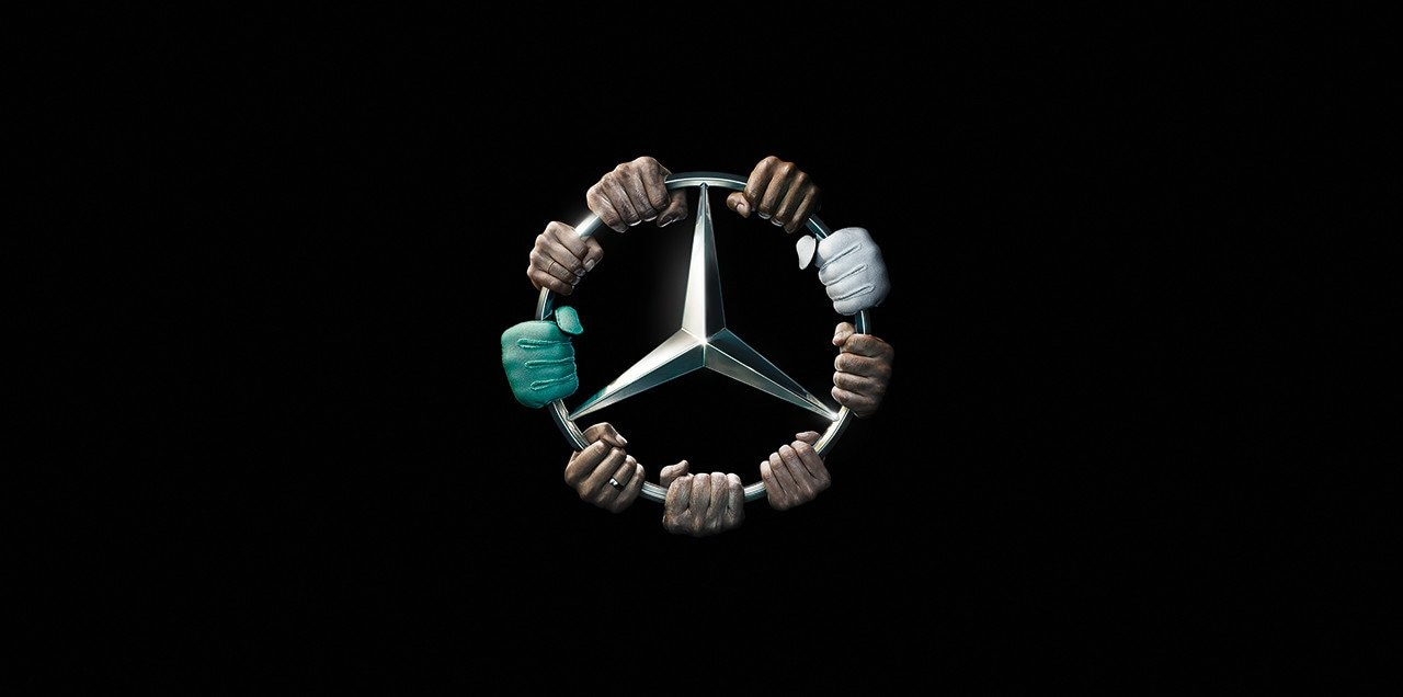 Beat the Triple: Mercedes star held by hands.
