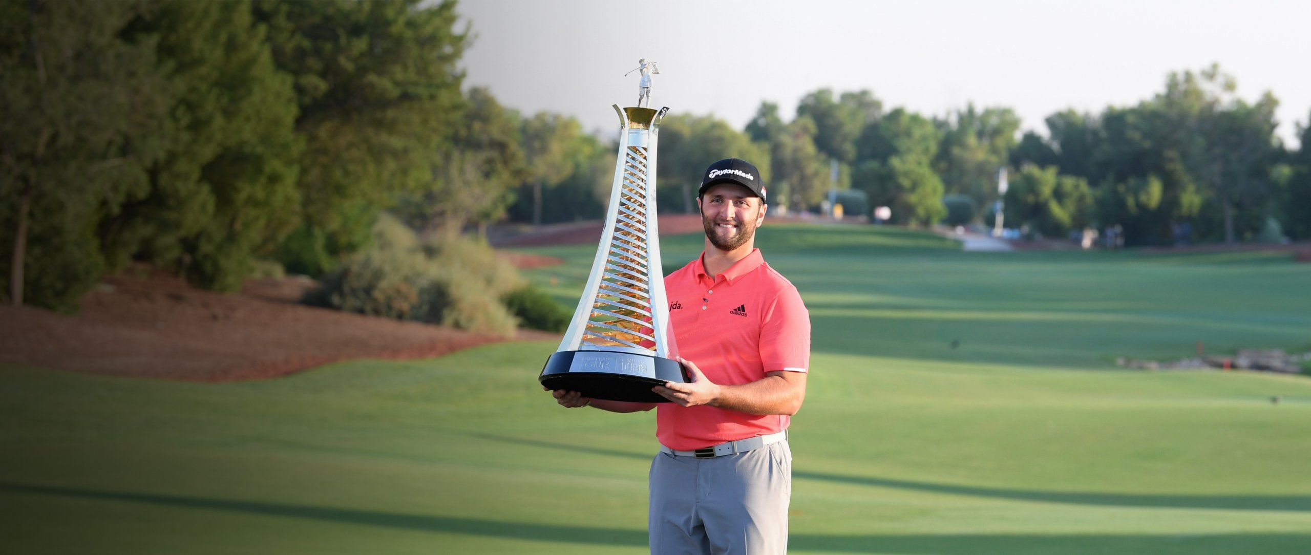 Jon Rahm lift the trophy he received for winning the Race to Dubai 2019.