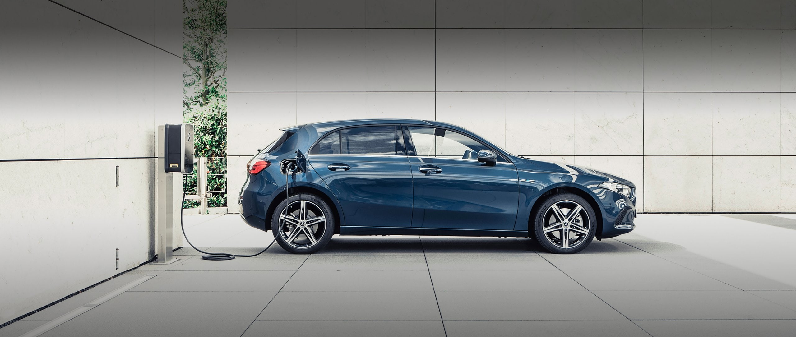 The Mercedes-Benz A-Class standing at a charging station.
