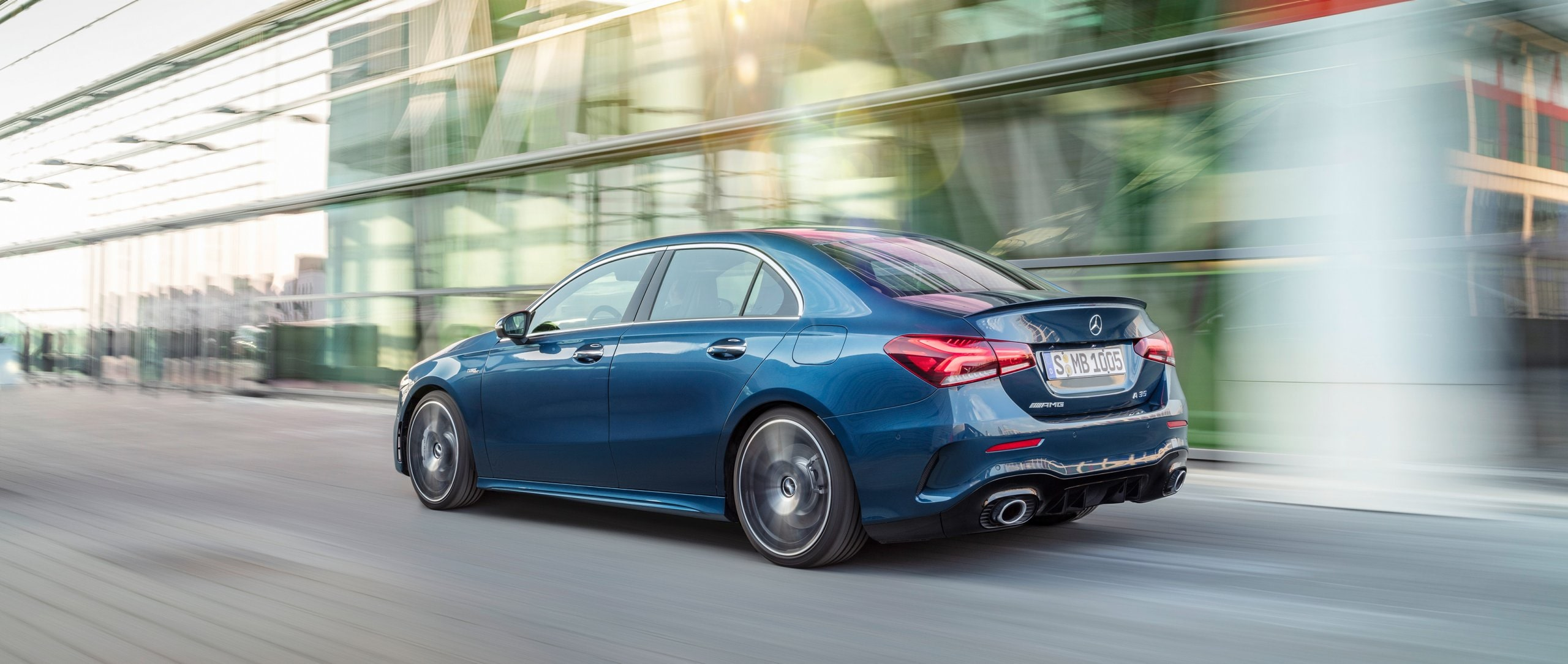 The new 2019 Mercedes-AMG A 35 4MATIC Saloon (V 177) in denim blue metallic in rear view.