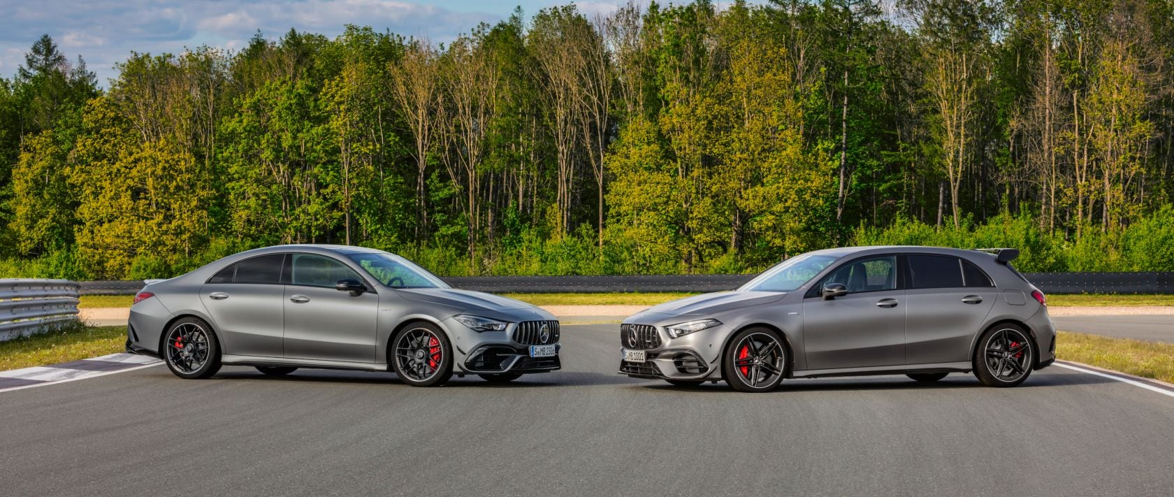 The new 2020 Mercedes-AMG A 45 4MATIC+ (W 177) and CLA 45 4MATIC+ (C 118) in designo mountain grey magno face each other.