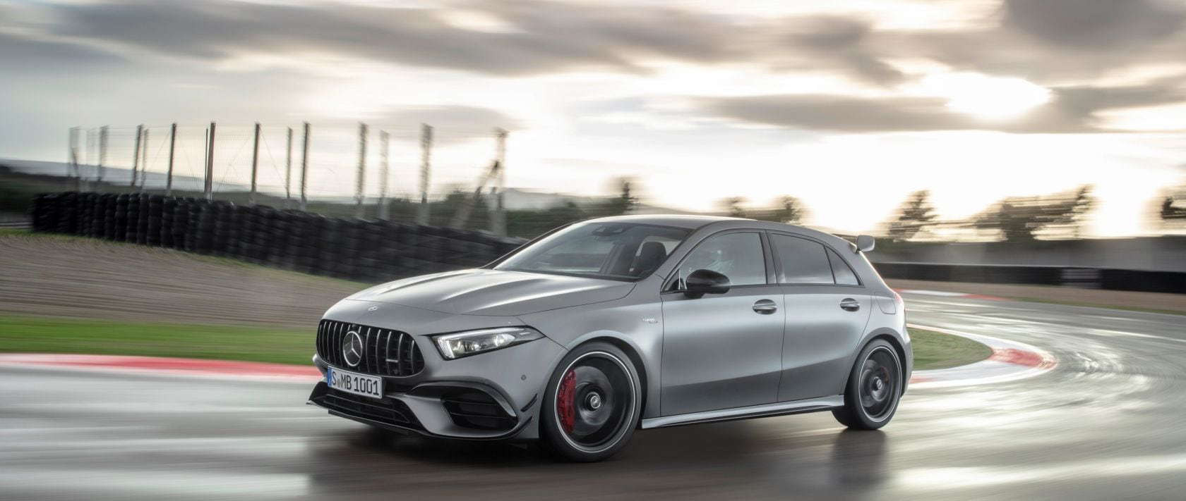 The new 2020 Mercedes-AMG A 45 4MATIC+ (W 177) in designo mountain grey magno in the curve of a racetrack.