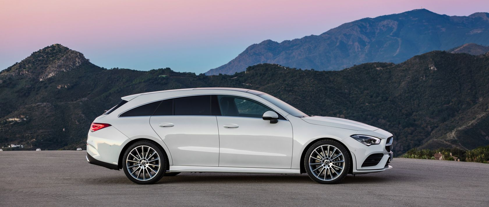 The 2019 Mercedes-Benz CLA Shooting Brake (X 118) with AMG Line in digital white metallic in side view.