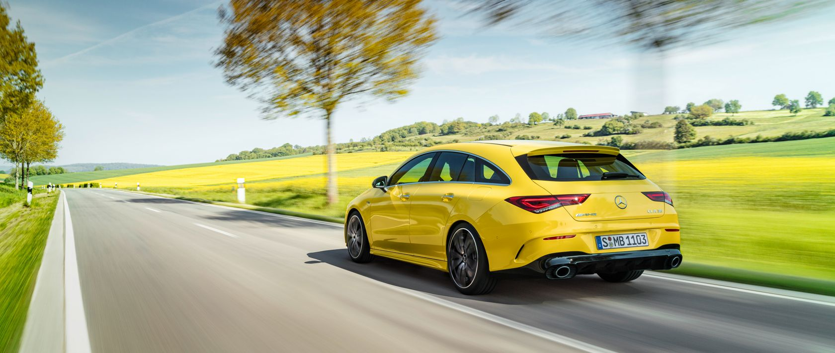 The new 2019 Mercedes-AMG CLA 35 4MATIC Shooting Brake (X 118) in sun yellow in rear view on a country road.