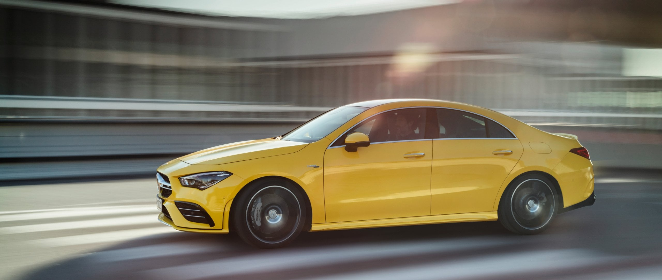 Side view of the new 2019 Mercedes-AMG CLA 35 4MATIC (C 118) in sun yellow.