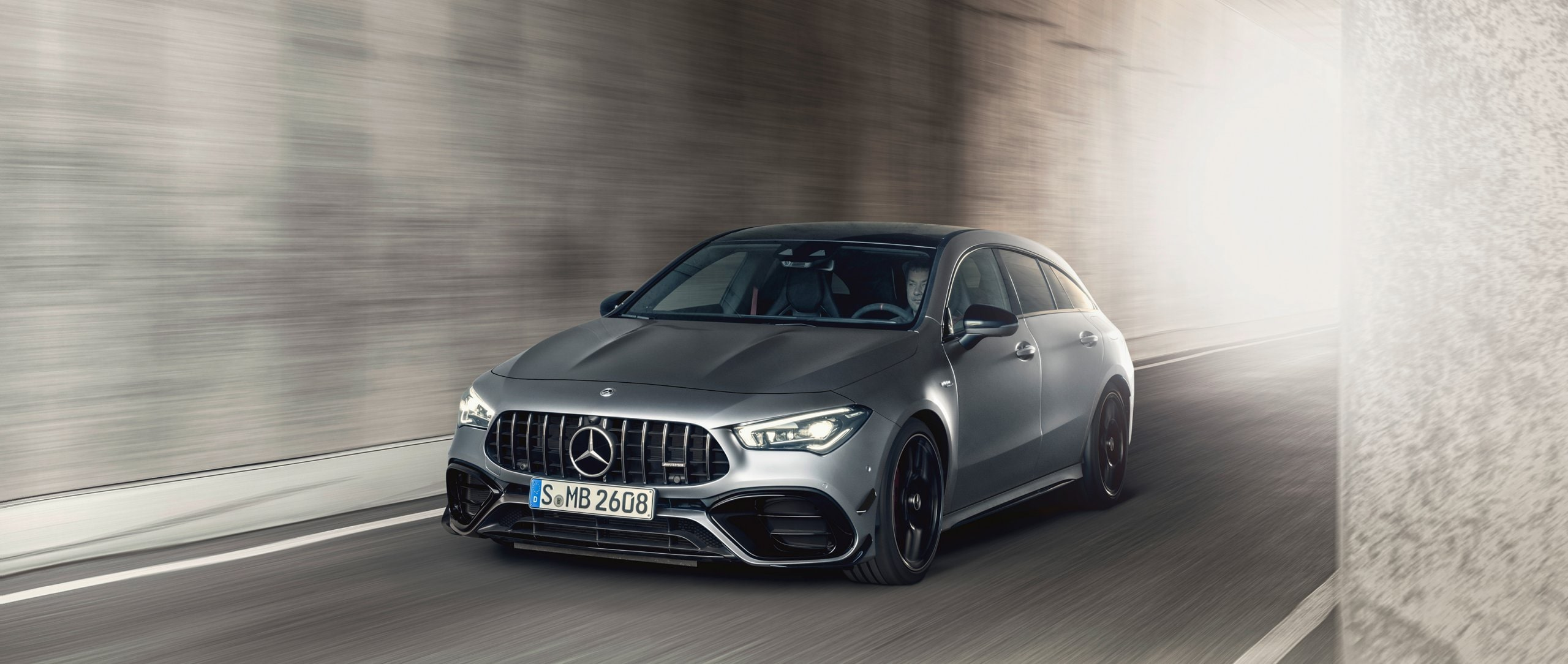Mercedes-AMG CLA 45 S 4MATIC+ Shooting Brake (X 118) (2020) in designo mountain grey magno in front view in a tunnel