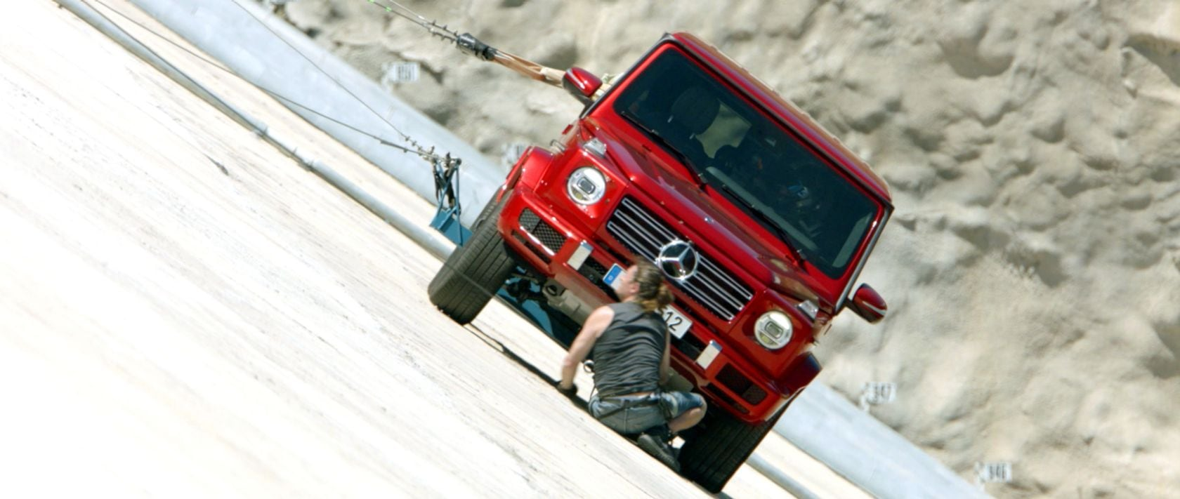 The Mercedes-Benz G 350 d (W 463) in designo hyacinth red metallic is secured at the Punta Negra dam.