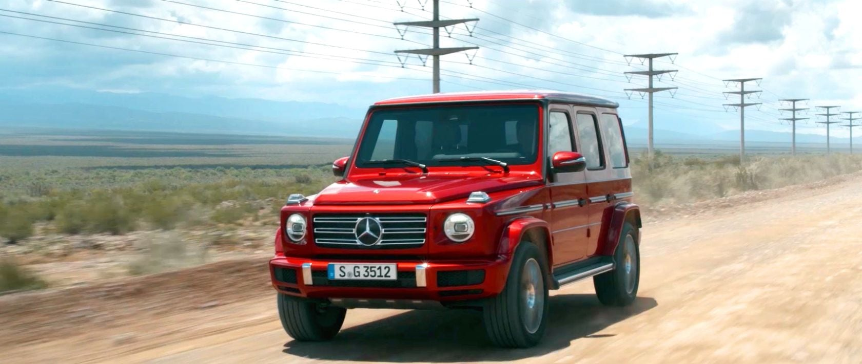 The Mercedes-Benz G 350 d (W 463) in designo hyacinth red metallic on a dirt road in Argentina.