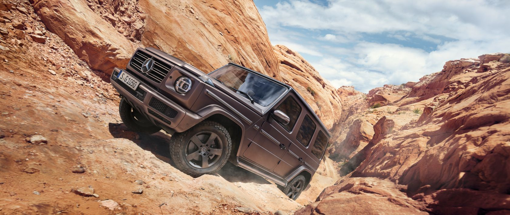 The new 2019 Mercedes-Benz G-Class (W 463) on a dirt road.