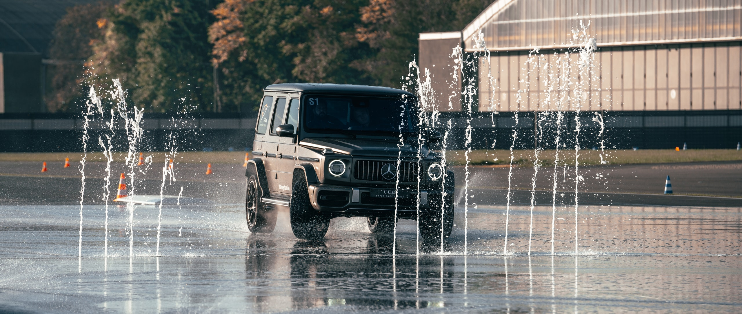 The Mercedes-Benz G-Class driving on wet track.