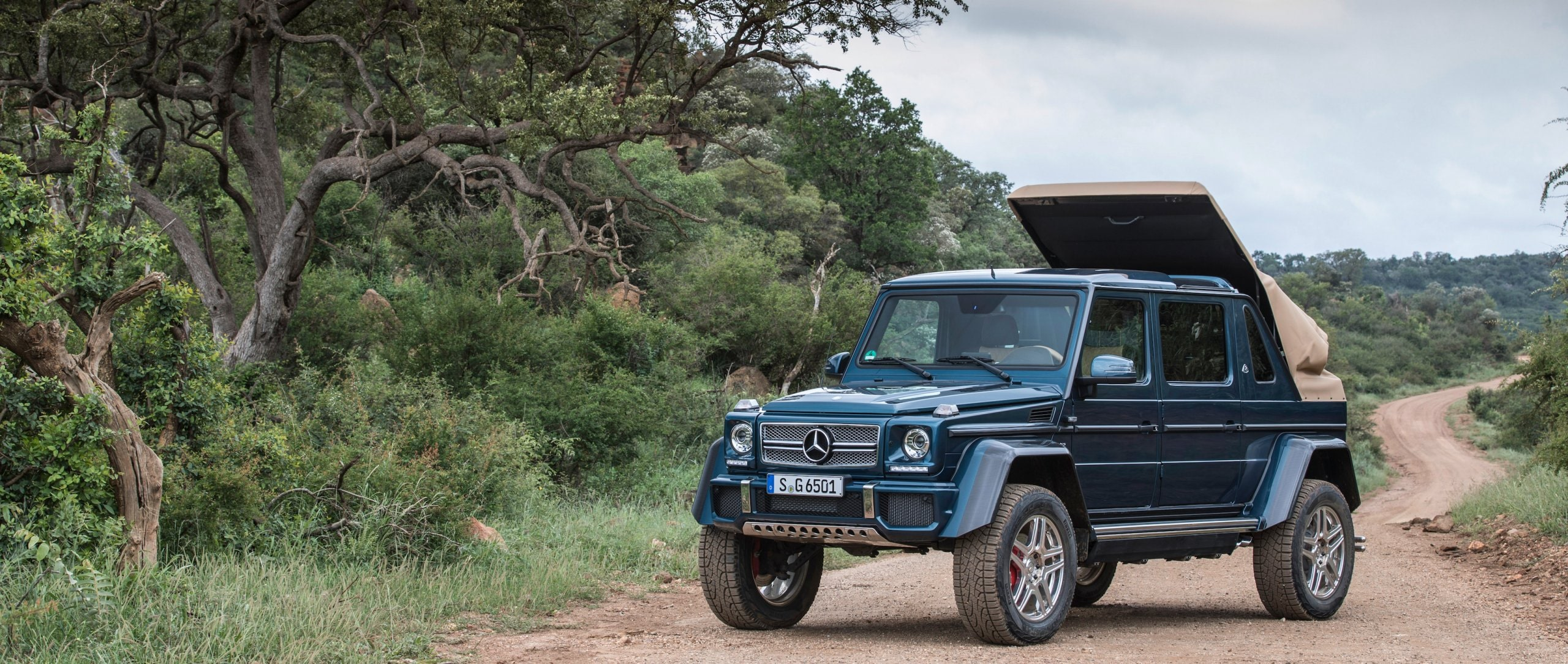 Front view of a Mercedes-Maybach G 650 Landaulet in an African landscape