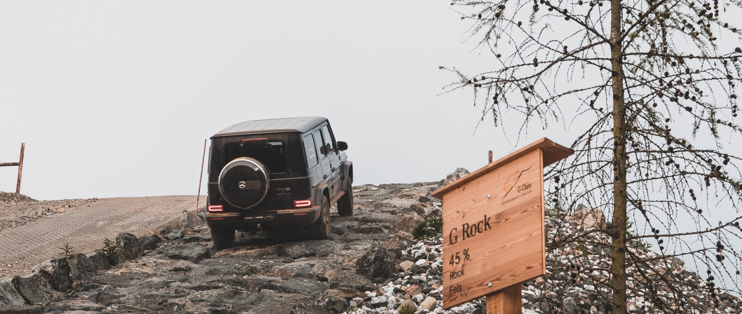 The Mercedes-Benz G-Class (W 463) in black climbing a steep slope.