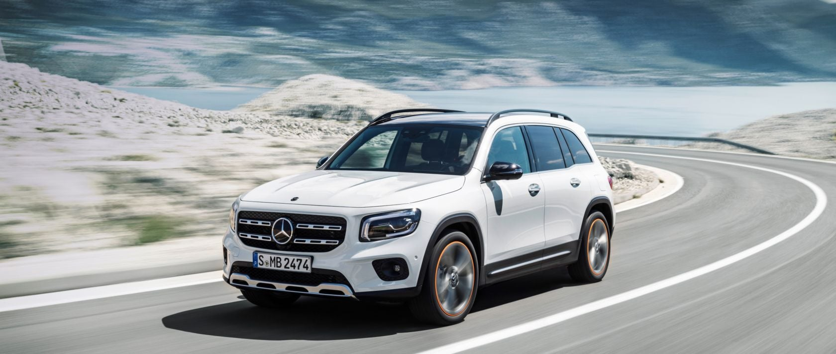 The new 2020 Mercedes-Benz GLB (X 247) in polar white on a coastal road.