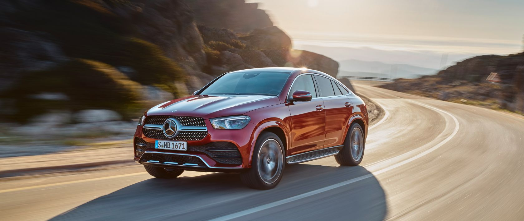 The new 2020 Mercedes-Benz GLE Coupé (C 167) in designo hyacinth red metallic at sunset.
