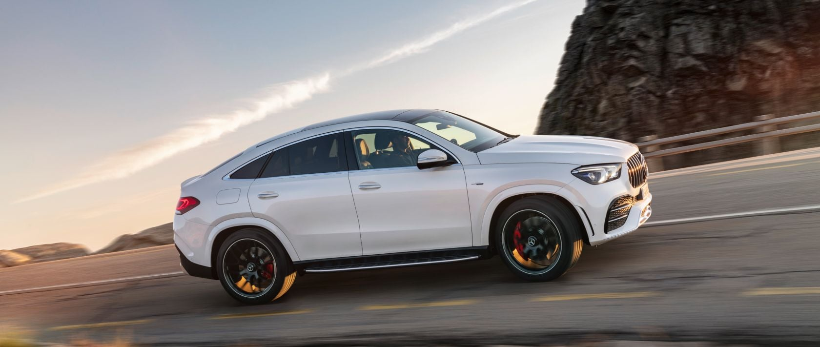 The new 2020 Mercedes-AMG GLE 53 4MATIC+ Coupé (C 167) in designo diamond white bright on a country road.