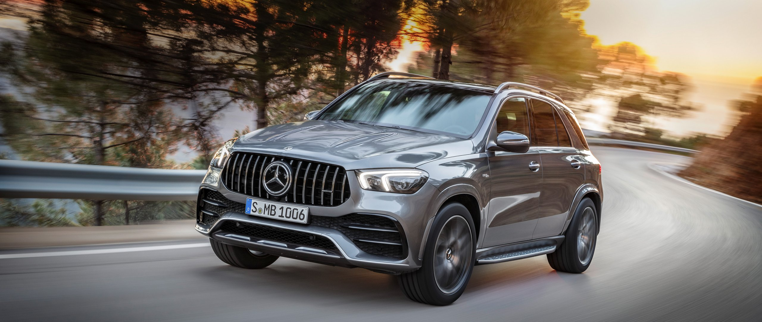 The 2019 Mercedes-AMG GLE 53 4MATIC+ (V 167) in selenite grey metallic on the road.