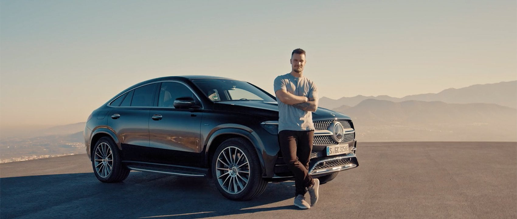 Paul Wallace stands in front of the Mercedes-Benz GLE Coupé.