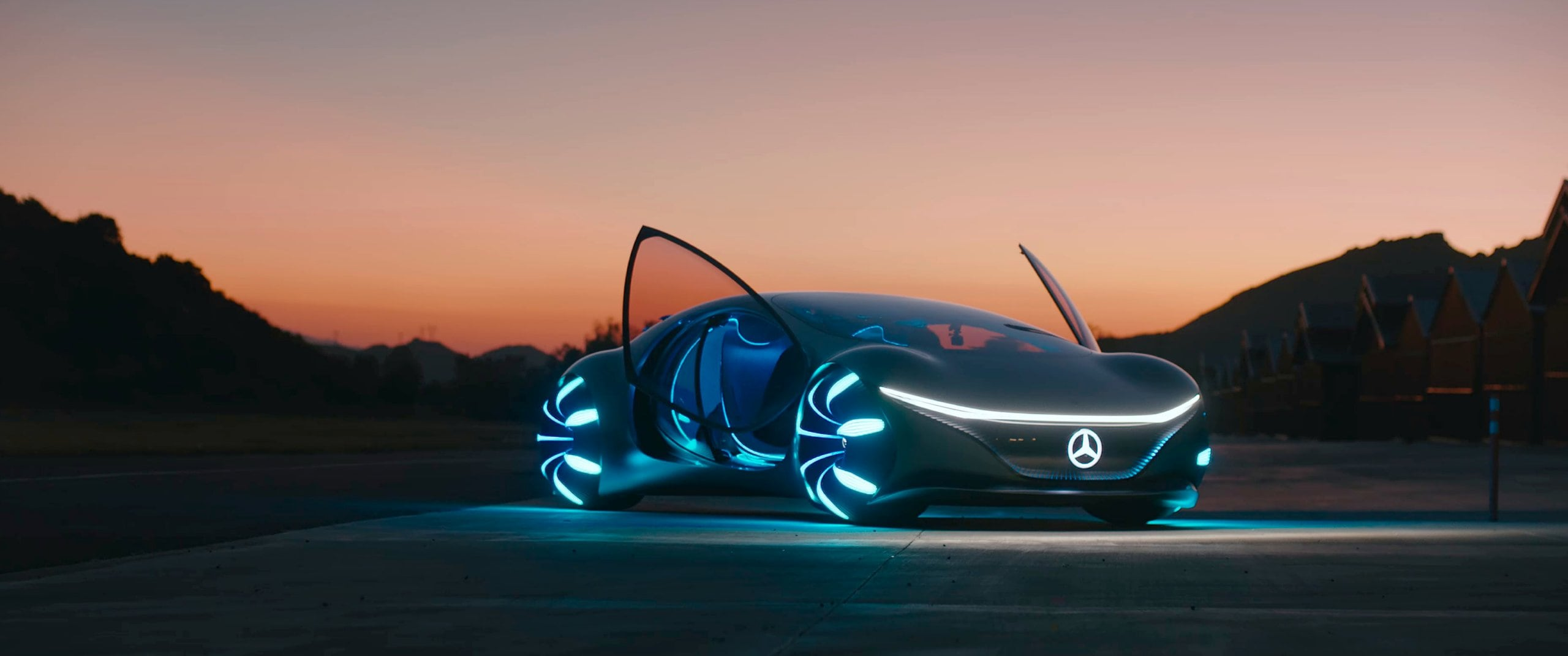 The Mercedes-Benz VISION AVTR standing on a runway at sunset.