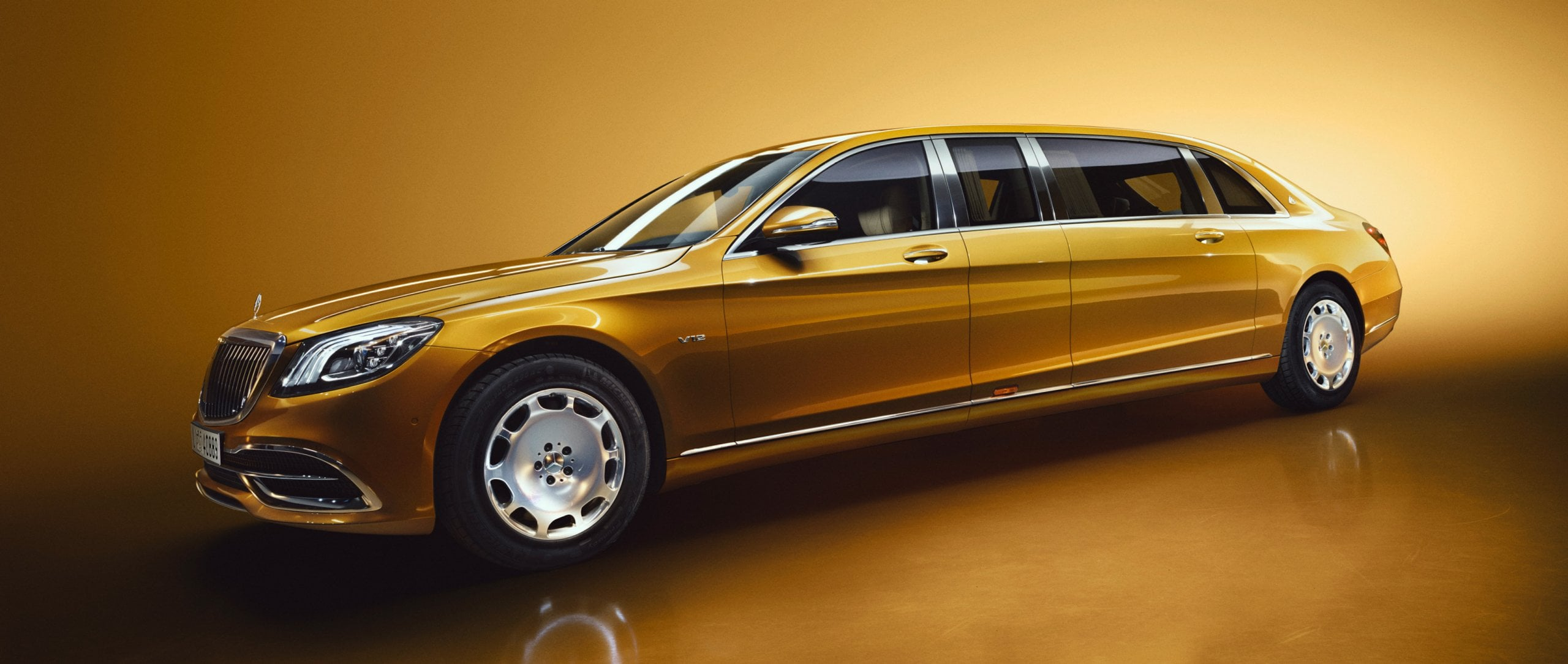 The Mercedes-Maybach S 650 Pullman in gold with golden background.
