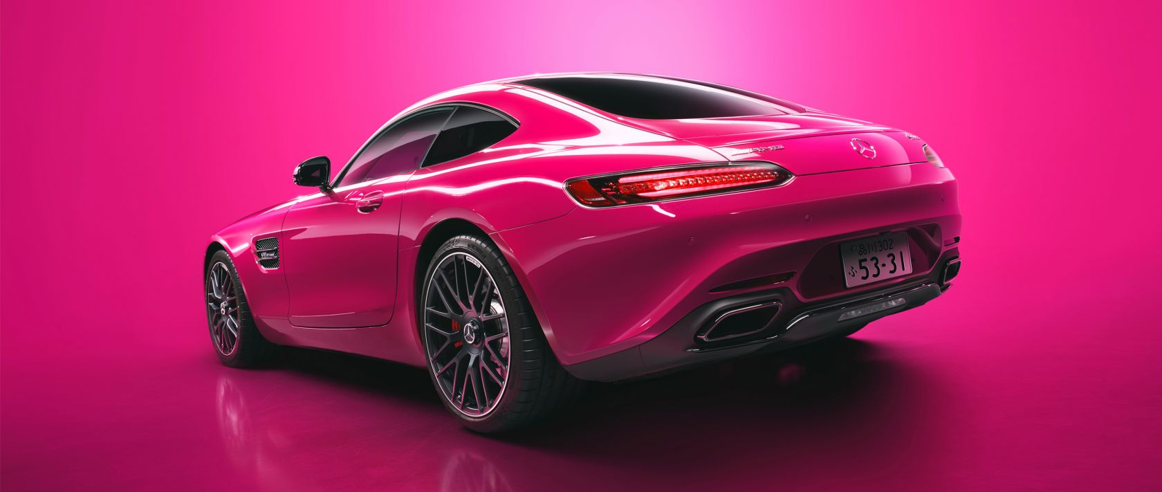 The Mercedes-AMG GT S in pink with pink background