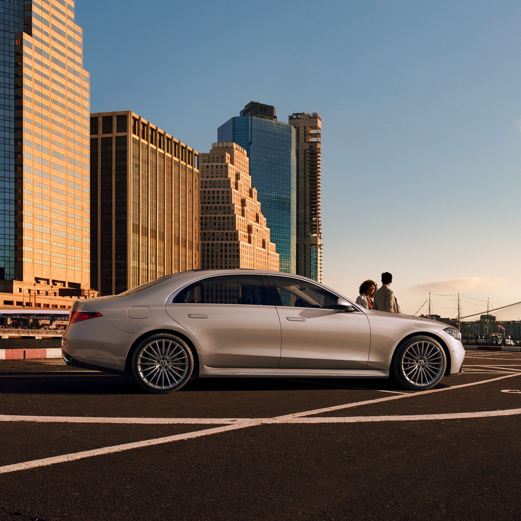 The new 2021 Mercedes-Benz S-Class Saloon (WV 223): A man leaning to the side against the front of the S-Class.