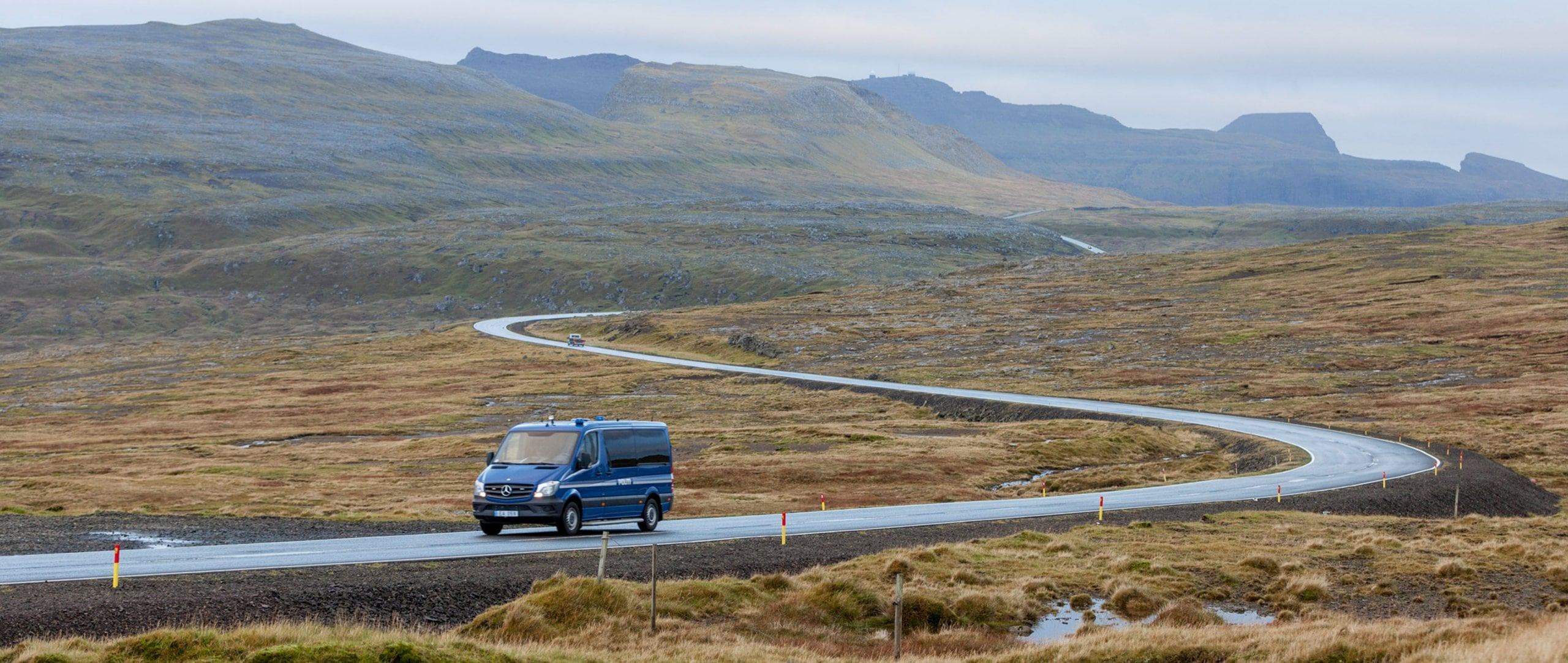 A Sprinter, driving through the rocky countryside of the Faroes